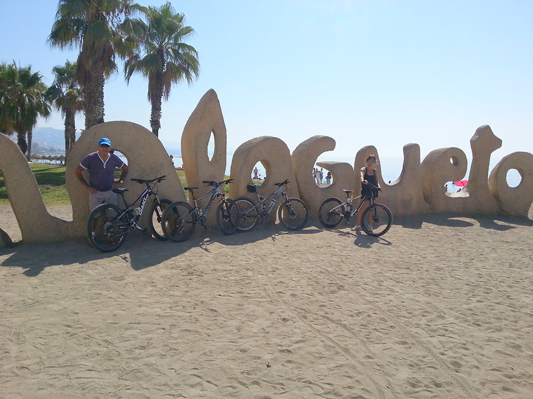 Malaga Seafront in front of the Malagueta beach sign