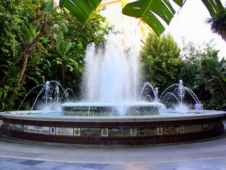 Puerto Banus Fountain in a shady botanical park in Marbella