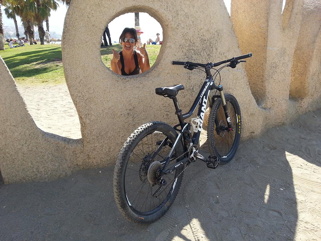 Malaga Seafront posing with bike with the Malagueta beach sign