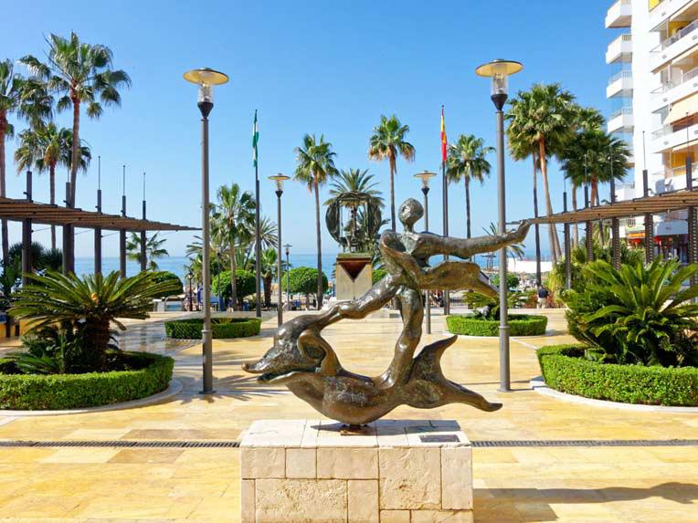 Puerto Banus Original statue in a park by the beach in Marbella