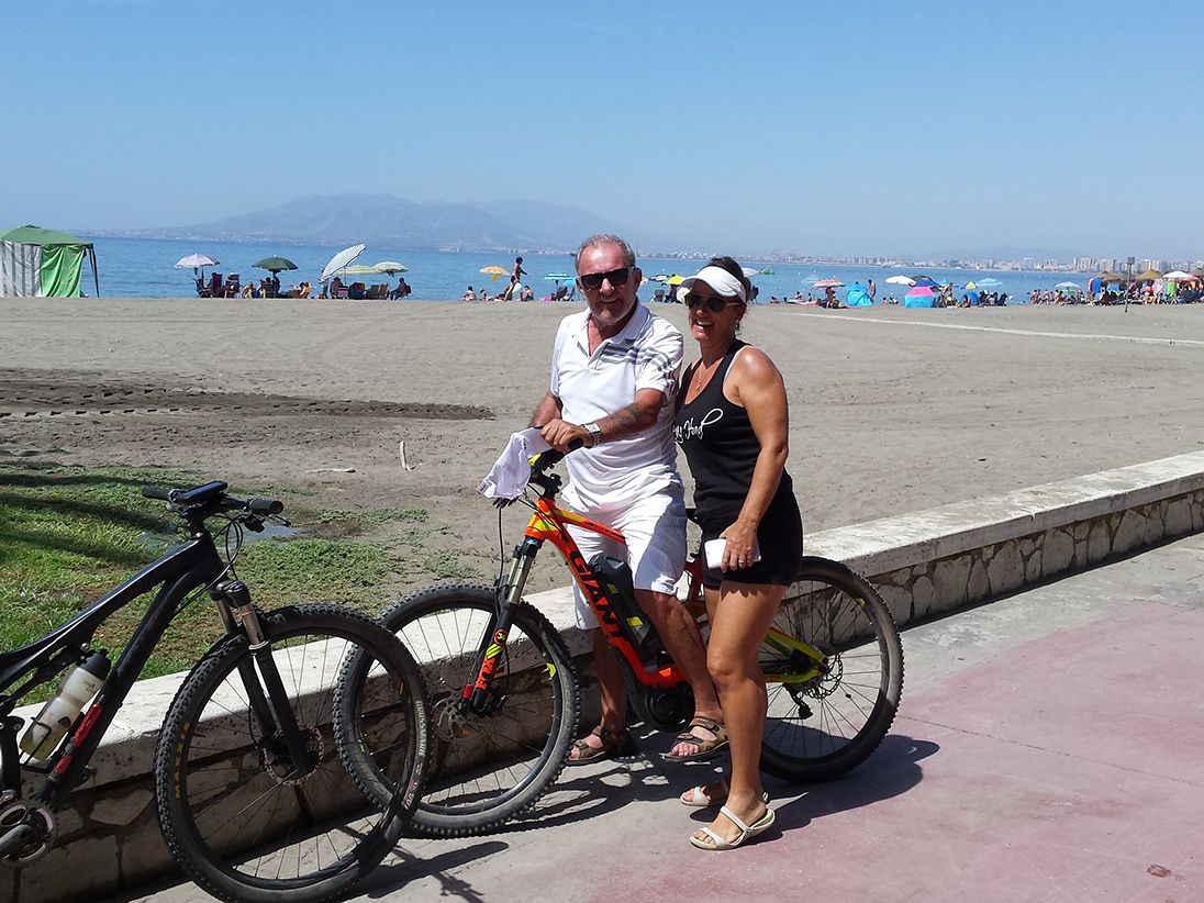 Malaga Seafront posing with bikes by the beach