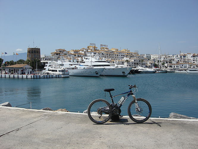 Puerto Banus Bike photo with luxury yacht in the port background