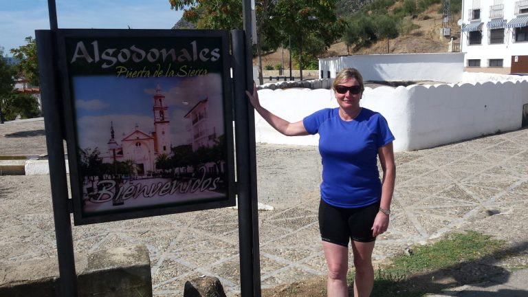 Rider posing in front of Algodonales welcome sign