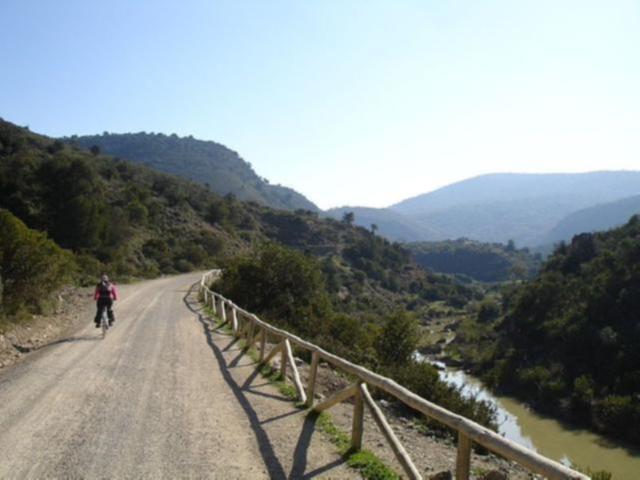 Via Verde de la Sierra dirt road alongside river