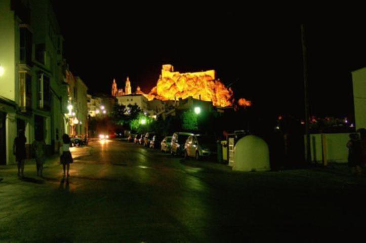 Via Verde de la Sierra village at night with castle lit up