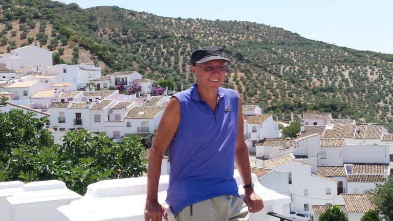 Zahara de la Sierra guide Alan posing in front of village and olive grove hills