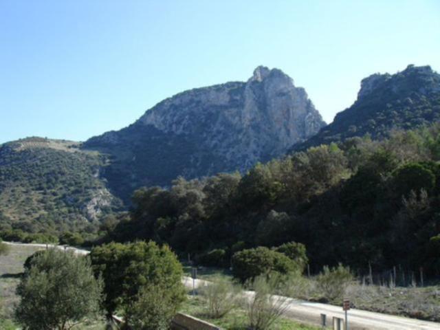 Via Verde de la Sierra countryside road with mountain background