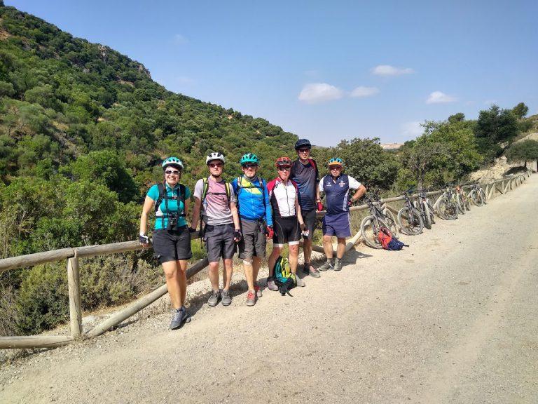 White Village Tour of Andalucia group photo posing mountain background