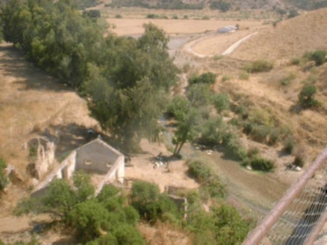 Via Verde de la Sierra olive grove hills in the background
