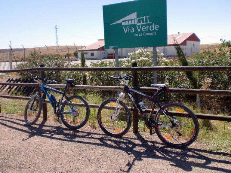 Via Verde de la Campiña bikes in front of sign