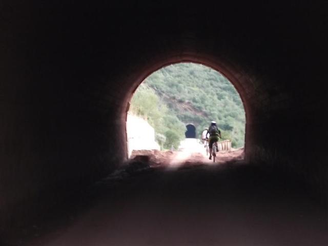 Via Verde de la Sierra cycling through tunnel
