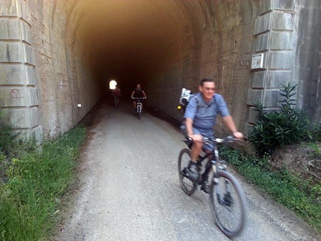 Via Verde de la Sierra riding out of tunnel
