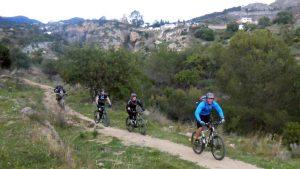 San Antón Sierra MTB guiding two riders on smooth flat singletrack