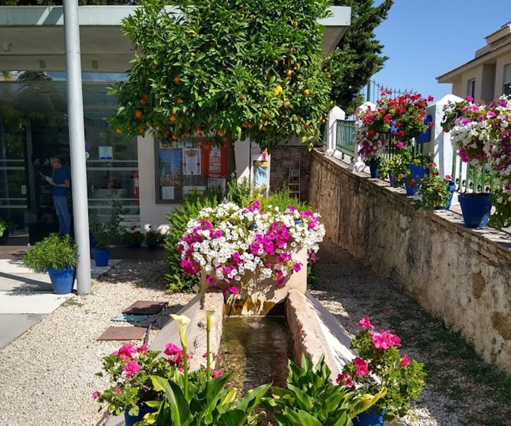 Via Verde del Aceite beautiful square with fountain and flowers