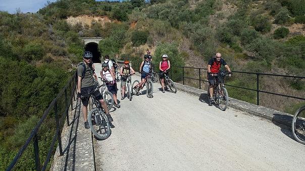 Via Verde de la Sierra group posing on bridge