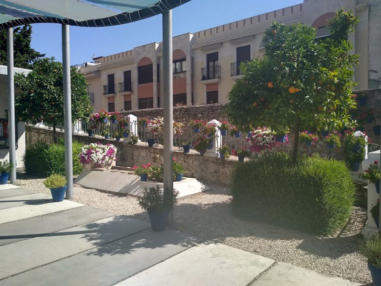 Via Verde del Aceite beautiful square with lovely flowers and fountain