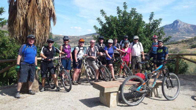 Zahara de la Sierra big group photo with bikes at viewpoint