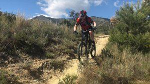 San Antón rider on smooth flowy dry trail
