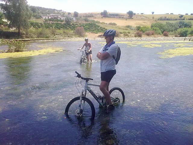 Rio Grande Wet feet posing with bike in the middle of the river