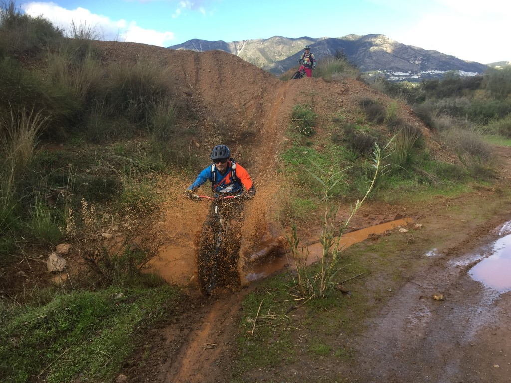 Mijas Down guide Clive riding through muddy people
