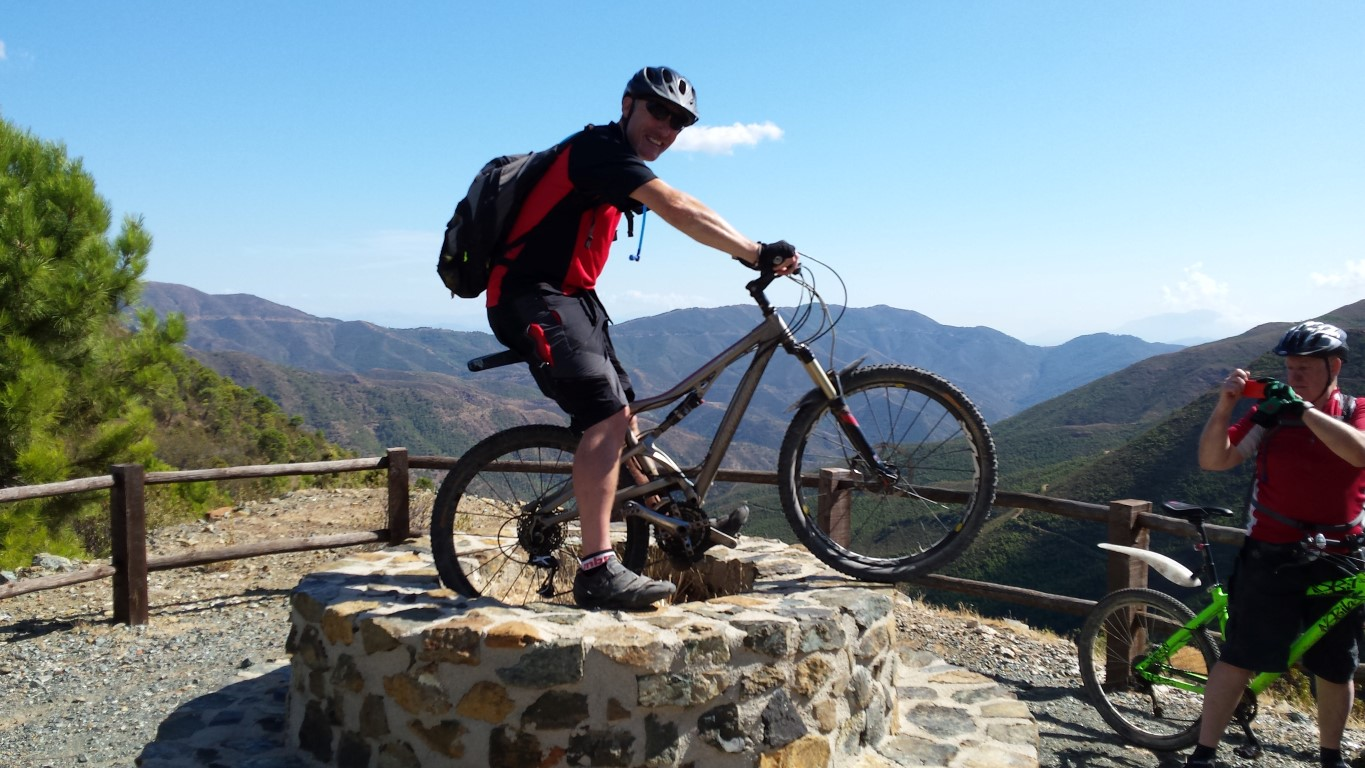 Ronda Descent posing with bike at the viewpoint