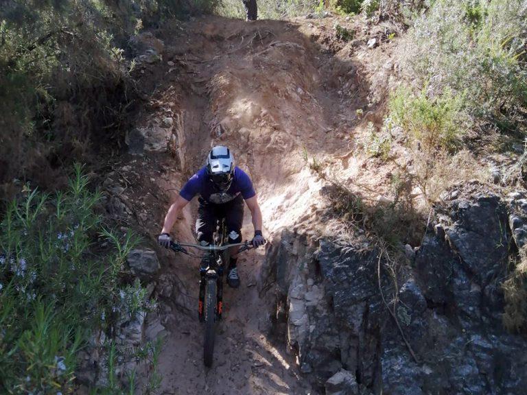 Ojen Enduro steep drop into sandy corner