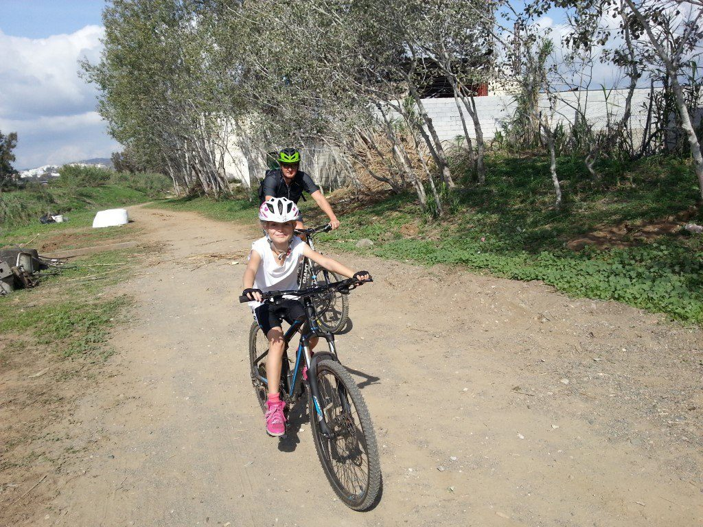 Sierra MTB Family ride Father and daughter riverbed