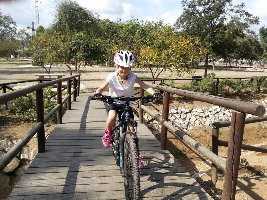 Sierra MTB Family ride Happy Kid crossing bridge