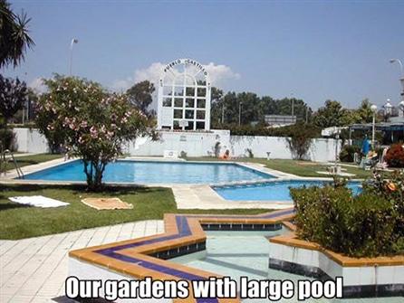 Pueblo Castillo gardens and pool